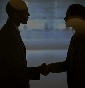 Silhouette of a handshake