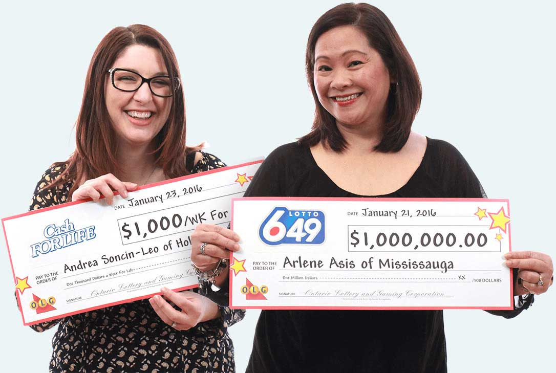 OLG two women holding cheques from winning the lottery