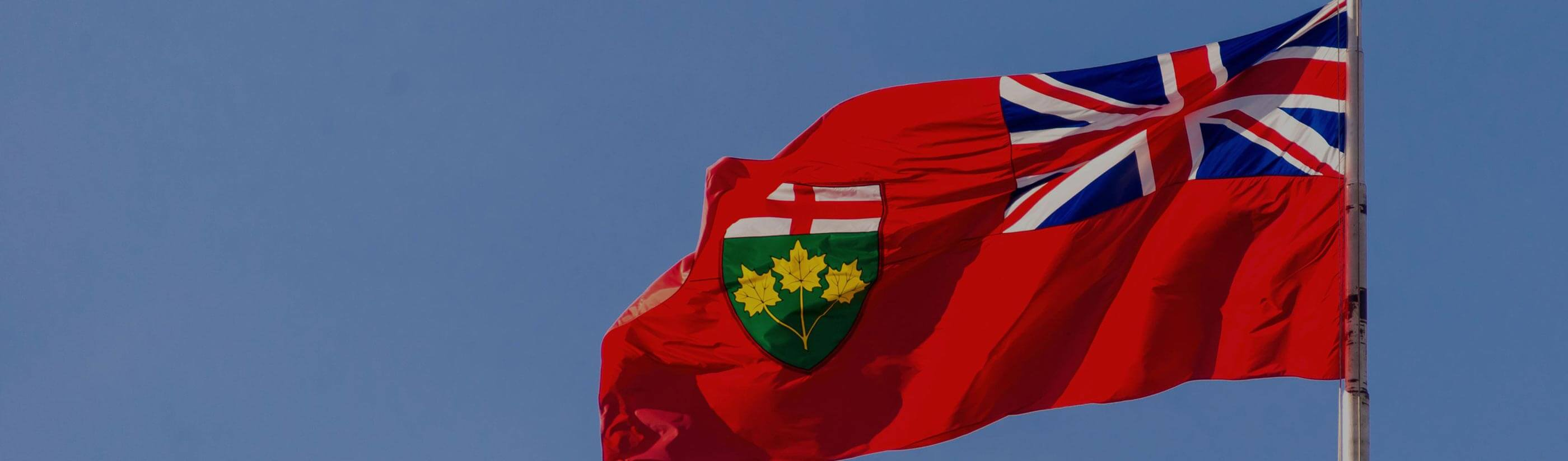 Ontario provincial flag and blue sky