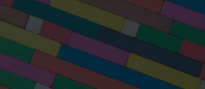 Colourful wooden rectangles stacked against each other.