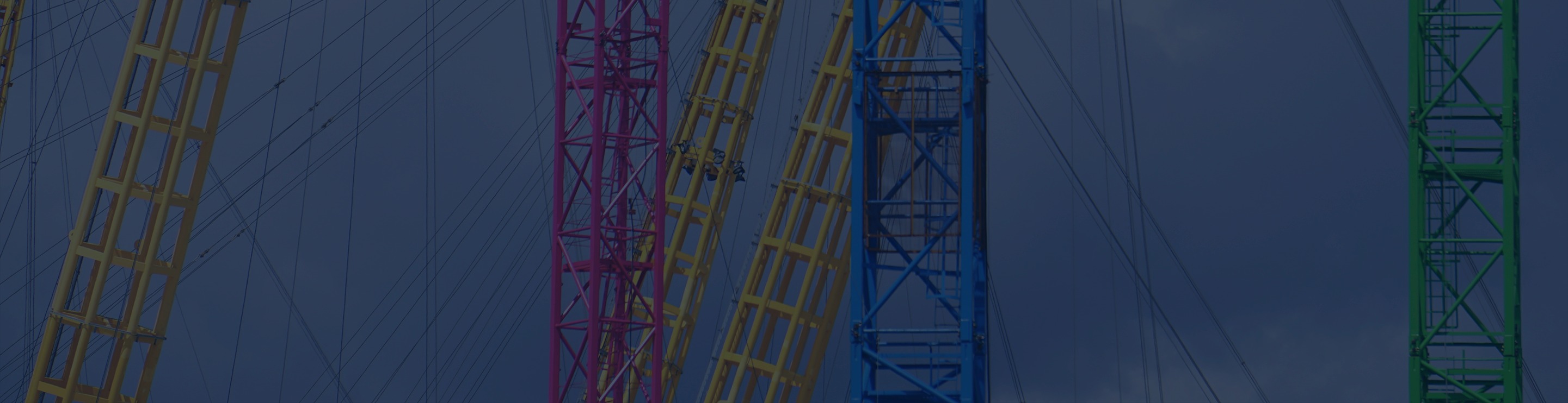 Colourful transmission towers in yellow, magenta, blue, and green.