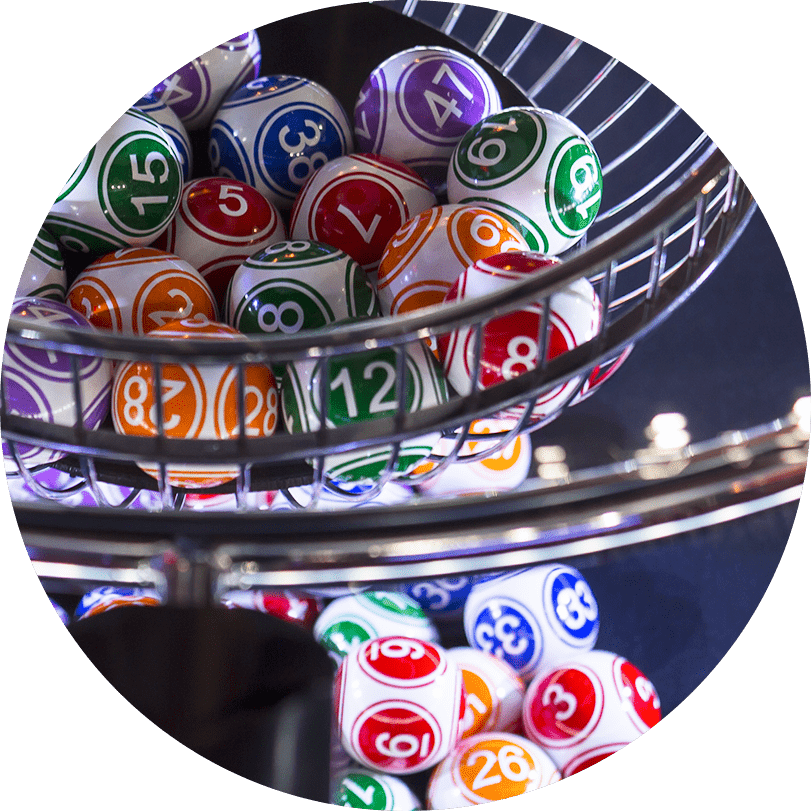 A lottery ball machine containing multiple lottery balls of different numbers and colours.